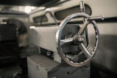 Handle clamp on a metalworking lathe. Tailstock of the lathe machine. stock photography