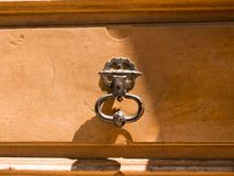 Handle detail on a door of a house in Annecy France. Handle detail on a door of a house in Annecy stock photo