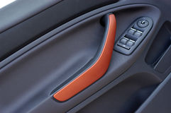 Handle on the door, car window control panel Stock Photo