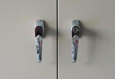 Handle of the door filing cabinet. Stock Photos