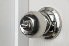 Handle on door knob. Handle on white door knob Stock Photo