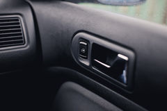Handle door opening in the vehicle. Window button. Royalty Free Stock Images
