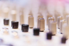 Handle the equalizer on a mixing console Royalty Free Stock Photos