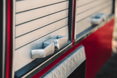 Handle fire engine compartments. Close-up Stock Photos