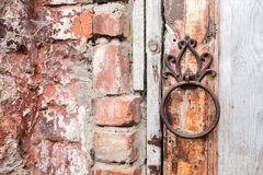 Handle is in the form of a ring on a wooden door. Entrance to the Rukavishnikov manor in the village of Podviazye royalty free stock image