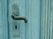 Handle on green door stock image