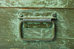 Handle on green old wooden box Stock Photo