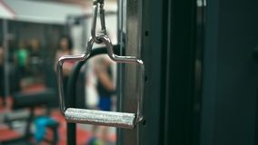 Handle on gym machine. Swinging, closeup, shallow depth of field. Stabilizer shot stock video