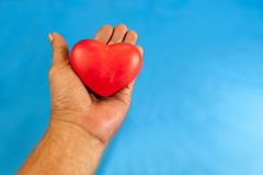 Handle with heart care Stock Photography