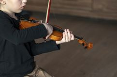 Handle hold violin. Boy carrying violin. Young boy playing violin, talented violin player. Musical instrument royalty free stock photos