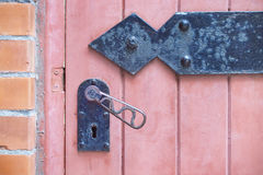 Handle and keyhole  on a red wooden door Royalty Free Stock Images