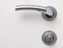 Handle and lock. Bright white Royalty Free Stock Photos
