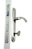 Handle and Lock. An isolated to white photo of an aluminium door handle Royalty Free Stock Images