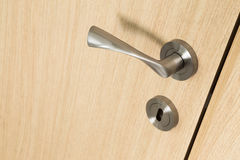 Handle and lock detail on a wooden door Royalty Free Stock Image