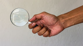 Handle magnifying glass buildings. Stock Photos