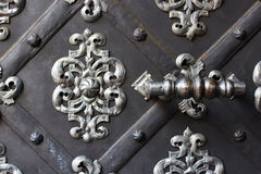 Handle and metal gates for entering the church Royalty Free Stock Photos