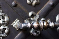 Handle and metal gates for entering the church Royalty Free Stock Images