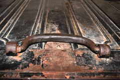 Handle of a metal rusted box Stock Images