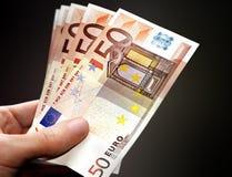 Handle Money. Hand handling fifty euros money stock photos