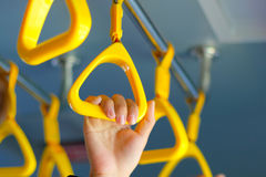 Handle on the MRT, prevent toppling.underground railway system o Royalty Free Stock Image