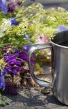 Handle mug with flowers Stock Photos