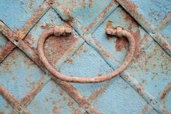 Rusty handle of an old blue chest royalty free stock photos