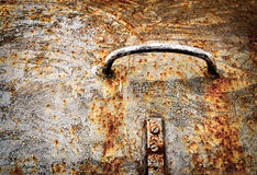 Handle on the old rusty iron hatch Stock Photo