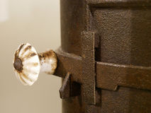 Handle on old rusty stones. Stock Photography