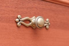 Handle old wooden chest of drawers closeup Stock Photography