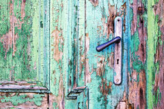 Handle on old wooden door Stock Photos