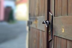 Handle. On an old wooden door Stock Photography