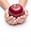 Handle red apples  on a white background. Royalty Free Stock Image