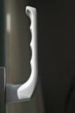 Handle. Regular white door handle in position Stock Image