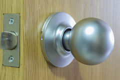 Handle. Round handle of a wooden door Royalty Free Stock Image