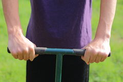 Handle. Someone using handles to garden, till, or lawn care Stock Images