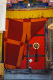 Handle to old temple door decorated with plaited tassel. Thiksey Royalty Free Stock Photography