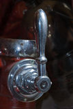 Handle of the water valve. Close-up of an old handle on the valve in the vintage fire engine Stock Photo