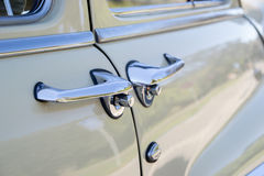 Handle of a white antique car. On the street Royalty Free Stock Photos