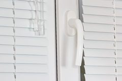 Handle white plastic office windows with shutters Royalty Free Stock Photography