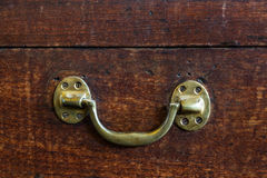 Handle on wood chest Stock Photography