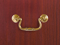 Handle on wooden box. Yellow handle on wooden box, closeup Stock Photo