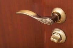 Handle and wooden door Royalty Free Stock Photos