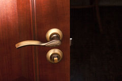 Handle and wooden door Royalty Free Stock Images