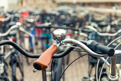 Handlebar with a bell. Focus on bicycle bell Royalty Free Stock Photography