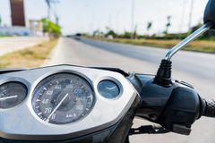The  handlebar of dirty motorbike parking at the left of road Royalty Free Stock Image