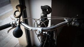 Handlebar with golden horn like a trumpet and acetylene headligh Stock Photo