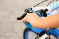 Handlebars and hand child in bicycle Royalty Free Stock Photo