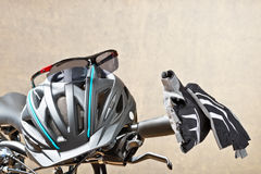 Handlebars With Sunglasses And Safety Helmet. Detail Of Handlebars With Sunglasses And Safety Helmet Stock Photo