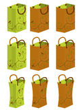 Handled gift bag 1. Green and brown bags with leaf and bird designs on them stock illustration