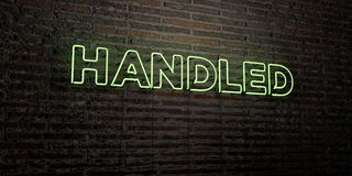 HANDLED -Realistic Neon Sign on Brick Wall background - 3D rendered royalty free stock image. Can be used for online banner ads and direct mailers royalty free illustration